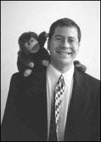 Dr. Seth Pollak with toy monkey on shoulder